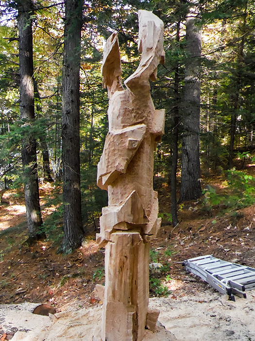 Carved trout totem poles